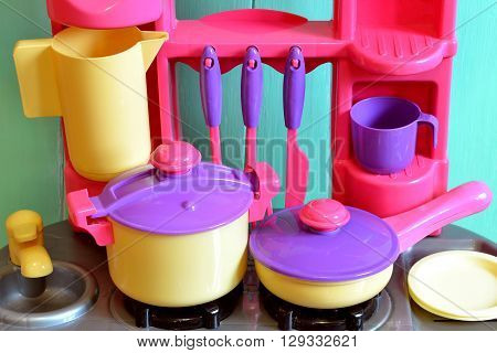 Set of kids dishes. Children's toys. Children's kitchen game. Kitchen utensils.