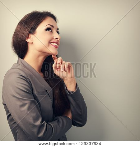 Happy Young Business Woman In Suit Thinking And Looking On Empty Copy Space. Toned Portrait