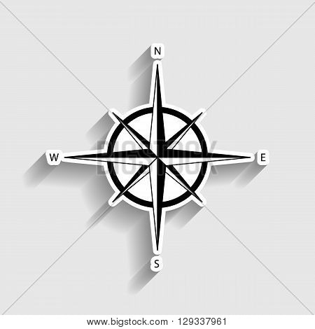 Wind rose sign. Sticker style icon with shadow on gray.