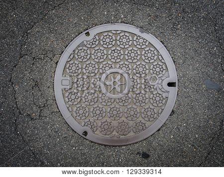 Circle Steel Manhole Cover On Asphalt Street