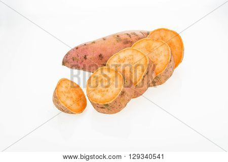 Fresh sweet potatoes whole and sliced isolated on white background