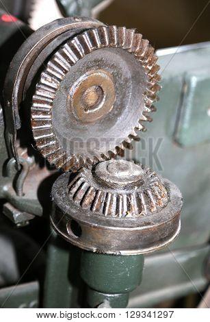 Big Mechanical Gear With The Oiled Metal Teeth