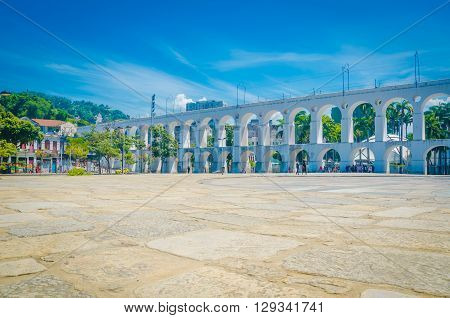 Landmark White Arches Of Arcos Da Lapa Under Bright Blue Skies In Centro Of Rio De Janeiro Brazil