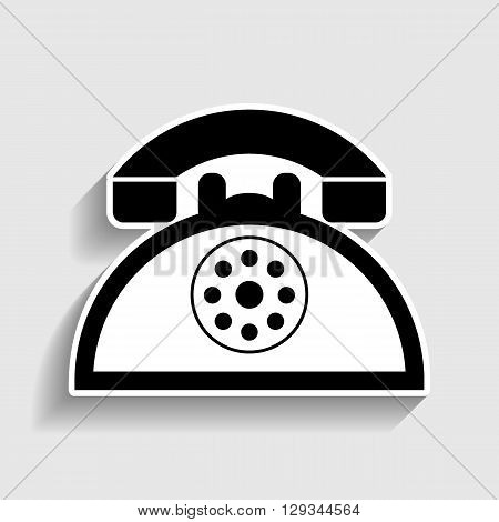 Retro telephone sign. Sticker style icon with shadow on gray.