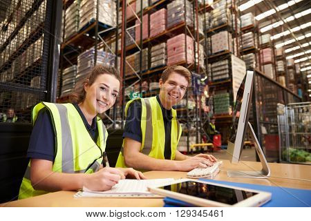 Staff in the office of a distribution warehouse, to camera