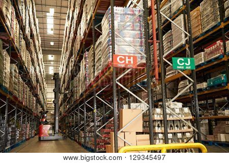 Moving stock in a distribution warehouse with an aisle truck