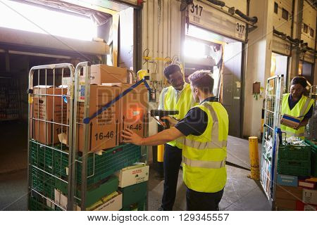 Warehouse manager overseeing the preparation of a delivery