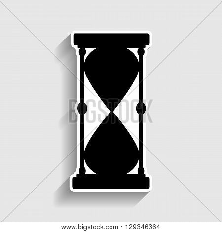 Hourglass sign. Sticker style icon with shadow on gray.