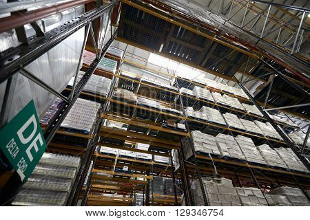 Low angle view of tall shelving racks at a warehouse