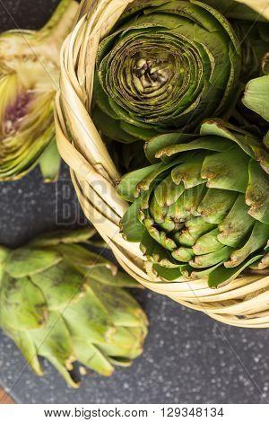 Fresh Artichokes In Wicker Basket Macro Shot