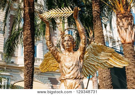 Cannes, France - June 28, 2015: Bronze statue of an angel with a palm branch at the InterContinental Carlton Cannes hotel.