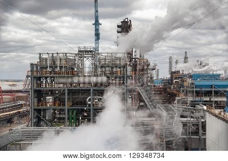 Chemical plant for production of ammonia and nitrogen fertilization on day time. The steam from the cooling system