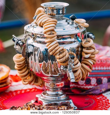 Traditional Russian Samovar With Bagels Is On Table.