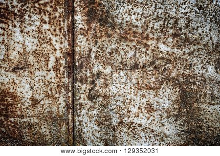 Rust on a metal surface with falling-off paint