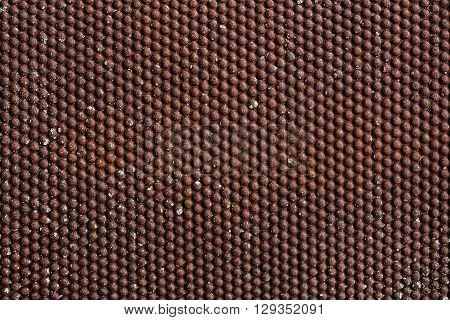 Old, rusty metal sheet with pimples for grunge background