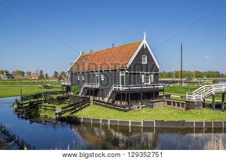 Wooden cottage at the lake in Enkhuizen Holland