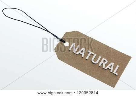 NATURAL word on cardboard tag on white background.Isolated