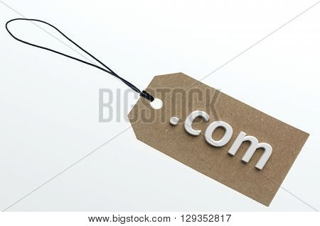 com link  on cardboard label.Isolated