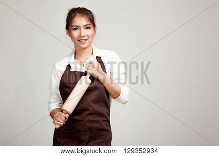 Asian Baker Woman  In Apron  With Wooden Rolling Pin