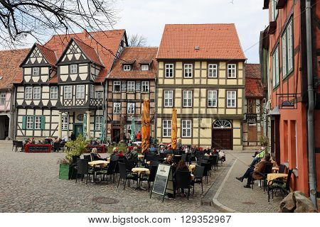 Quedlinburg, Germany - April 09, 2016: Half-timbered houses on Schlossberg in Quedlinburg in Saxony-Anhalt. A popular place fpr Tourists and local People