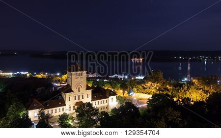 Night city Drobeta-Turnu Severin, view of the Danube and the fire department