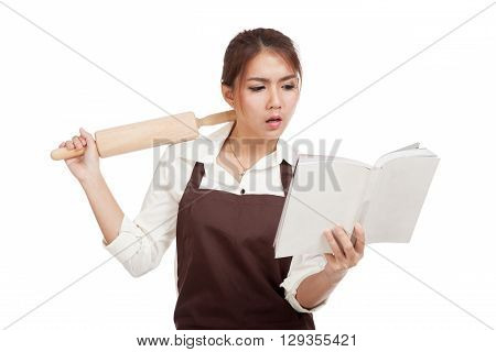 Asian Baker Woman  In Apron  With Wooden Rolling Pin And Cook Book