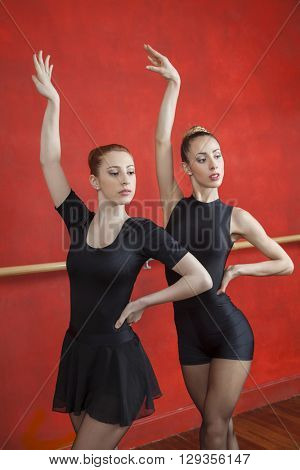 Ballerinas Practicing With Hands Raised In Rehearsal Room