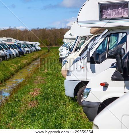 rows of motorhomes on a parking space