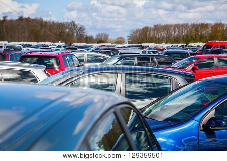 mass of parked cars on a parking space