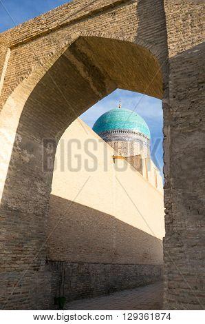 Uzbekistan Bukhara side view of the Mir-i-Arab madrassah blue dome