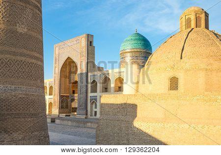 Uzbekistan Bukhara the Mir-i-Arab madrassah with the Kalon minaret on the left