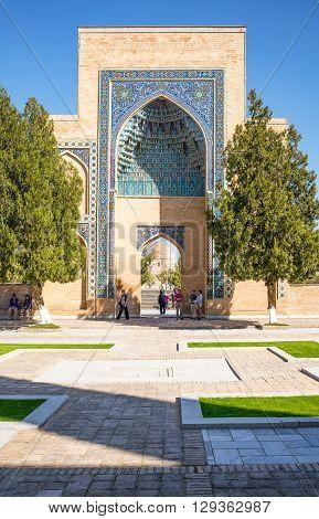 Samarkand Uzbekistan - April 18 2014: People near the portal leading to the Registan square