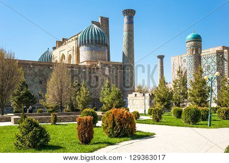 Uzbekistan Samarkand the garden leading to the Registan square with the wanderful mosque and madrassah