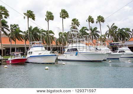 Motor yachts in the harbor from Aruba island in the Caribbean