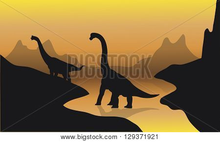 Silhouette of brachiosaurus in river at the sunset
