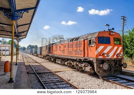 Crato, Portugal. July 2, 2015: Diesel locomotive, model 1960 - bombardier, with a freight train from Comboios de Portugal (Portuguese trains).