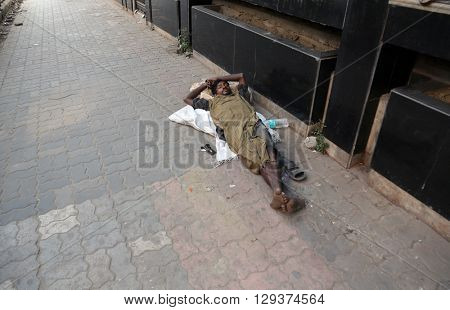 KOLKATA - FEBRUARY 09: Homeless people sleeping on the footpath of Kolkata. on February 09, 2014 in Kolkata, India