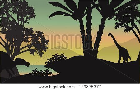 Silhouette of brachiosaurus in park a beautiful scenery