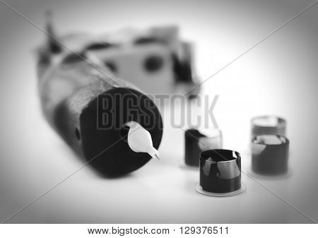 Tattoo machine with colorful ink isolated on white. Retro stylization