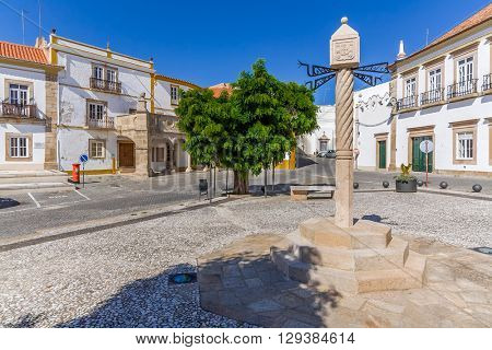 Town Square of Crato, with the Pillory, Sa Nogueira Palace on the right and Grao-Prior Veranda on the left. Alto Alentejo, Portugal.