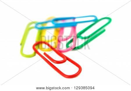 multi-colored paper clips on a white background