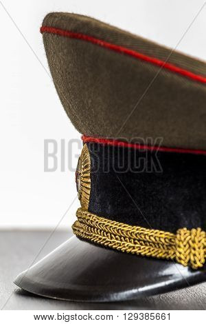 Visor military cap lying on the table close-up