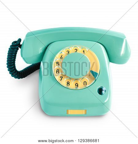 Vintage green telephone with rotary dial isolated on white background