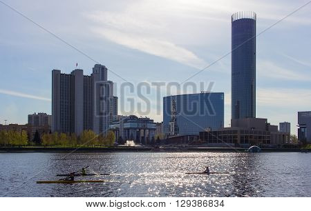 group of people on train kayak on city pond in Yekaterinburg