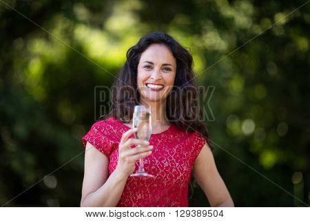 Portrait of happy young woman holding champagne flute