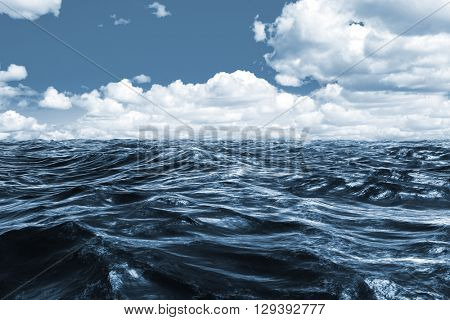 Blue rough ocean against scenic view of blue sky