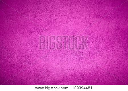 Abstract fuchsia plaster wall texture. Background and texture.