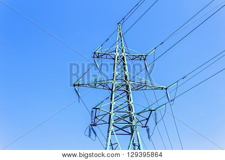 High tower power line on blue sky background