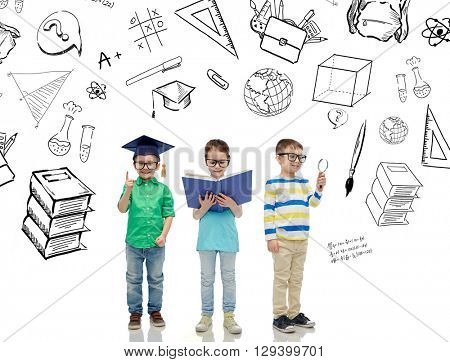 childhood, education, knowledge and people concept - happy little children in eyeglasses with book, magnifying glass and mortar board over school doodles
