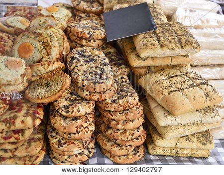 Baked goods at a bakery or market stall. Various pastries arrangement on a market stall.